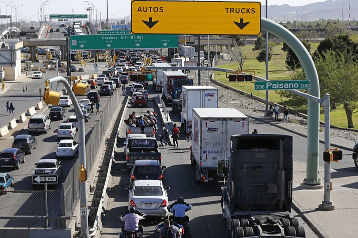 Cars and trucks line up to enter Mexico from the U.S. at a border crossing in El Paso, Texas, on March 29, 2019. A transgender asylum seeker has died just days after being released from a U.S. immigration detention center where advocates say detainees are mistreated. (Gerald Herbert/AP, file)