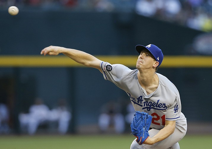 Los Angeles Dodgers pitcher Walker Buehler throws in the first inning of a game against the Arizona D-backs, Monday, June 3, 2019, in Phoenix. (Rick Scuteri/AP)