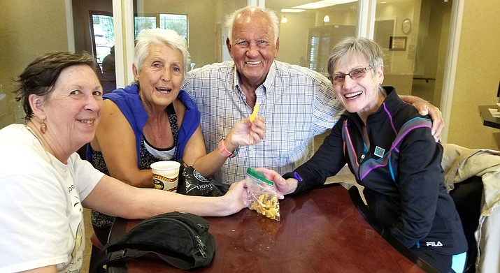 Ray Hortenske's dehydrated fruit gives just the right energy to Carolyn Fisher, Penny Mathieuand Barbara Mallek.