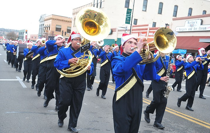 The Prescott High School marching band participates in the downtown Christmas parade Dec. 1, 2018, in Prescott. The Pride of Prescott Marching Band and String Orchestra has been invited to perform in the Pearl Harbor memorial commemoration events on Dec. 7, 2019 in Honolulu, Hawaii. The Prescott Unified Governing Board will be asked to vote at its meeting at 5 p.m. Tuesday, June 4, on the request. (Les Stukenberg/Courier, file)