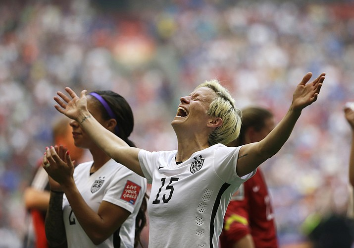In this July 5, 2015, photo, United States' Megan Rapinoe celebrates after the U.S. beat Japan 5-2 in the FIFA Women's World Cup championship in Vancouver, British Columbia. The U.S. national team, ranked No. 1 globally, will try to defend its title in soccer's premier tournament, which kicks off on June 7. (Elaine Thompson/AP, File)