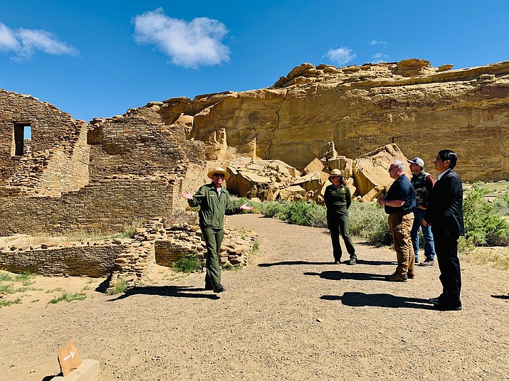 Interior Secretary David Bernhardt, third from left, tours Chaco Culture National Historical Park about 95 miles northeast of Gallup, New Mexico, May 28. U.S. Sen. Martin Heinrich of New Mexico is at Bernhardt's right. Navajo Nation President Jonathan Nez is on the far right. (Jared Touchin/Navajo Nation via AP)
