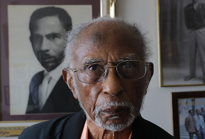 World War II veteran Johnnie Jones, Sr. poses for a portrait at his home in Baton Rouge, La., Tuesday, May 28, 2019. Jones, who joined the military in 1943 out of Southern University in Baton Rouge, was a warrant officer in a unit responsible for unloading equipment and supplies onto Normandy. He remembers wading ashore and one incident when he and his fellow soldiers came under fire from a German sniper. He grabbed his weapon and returned fire along with the other soldiers. It's something that still haunts his memories. (AP Photo/Gerald Herbert)