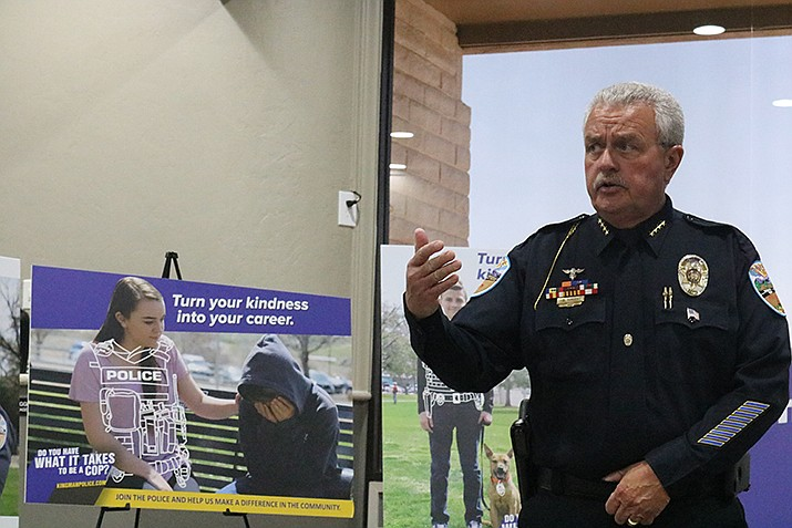 """Kingman Police Department Chief Bob DeVries says his department's new recruitment campaign shows the """"human side"""" of the profession. (Photo by Travis Rains/Daily Miner)"""