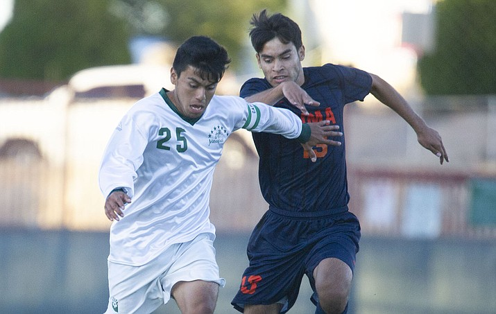 Yavapai's Jose Perez Flores (25) drives the ball upfield as the Roughriders take on the Pima Community College Aztecs Thursday, Sept. 20, 2018 at Ken Lindley Field in Prescott. The two-time NJCAA All-American midfielder will continue his athletic career at the University of Illinois at Chicago, an NCAA Division I program. (Les Stukenberg/Courier)