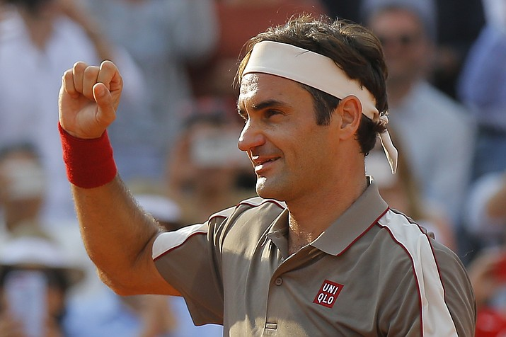 Switzerland's Roger Federer celebrates winning his quarterfinal match of the French Open against Switzerland's Stan Wawrinka in four sets, 7-6 (7-4), 4-6, 7-6 (7-5), 6-4, at the Roland Garros stadium in Paris, Tuesday, June 4, 2019. (Michel Euler/AP)