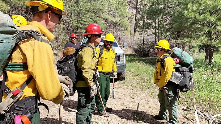 Firefighters practice hoselays and fire simulation at Station 6 during the North Zone Readiness Review for the 2019 Fire season. (Photo/Kaibab National Forest)