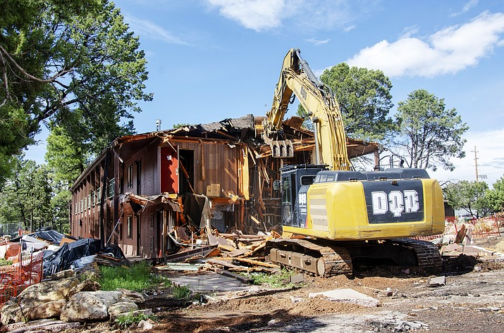 An excavator demolishes the last corner of a two-story, wood frame lodge building at Maswick South May 30. (Mike Quinn/NPS)