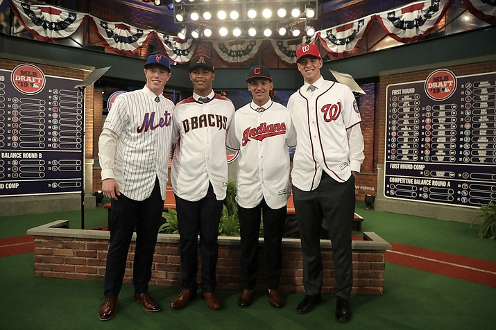 From left to right, prospects Brett Baty, Brennan Malone, Daniel Espino and Jackson Rutledge pose for photos after the first round of the Major League Baseball draft, Monday, June 3, 2019, in Secaucus, N.J. (Julio Cortez/AP)