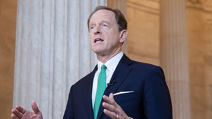 In this Oct. 2, 2018, file photo, Sen. Pat Toomey, R-Pa., speaks during a television news interview on Capitol Hill in Washington. (Scott Applewhite/AP)