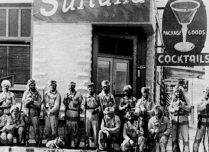 The Bill Williams Mountain Men circa 1950s featured on the front of a post card outside of the Sultana Bar in downtown Williams. (Photo/Williams Historic Photo Project)