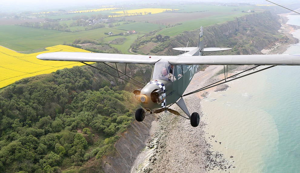 A Piper Cub with French Resistance hero Roland LePers flies over the beaches of Normandie during a 2009 tour of the Normandie region of France. (Bill Morrison/Courtesy photo)