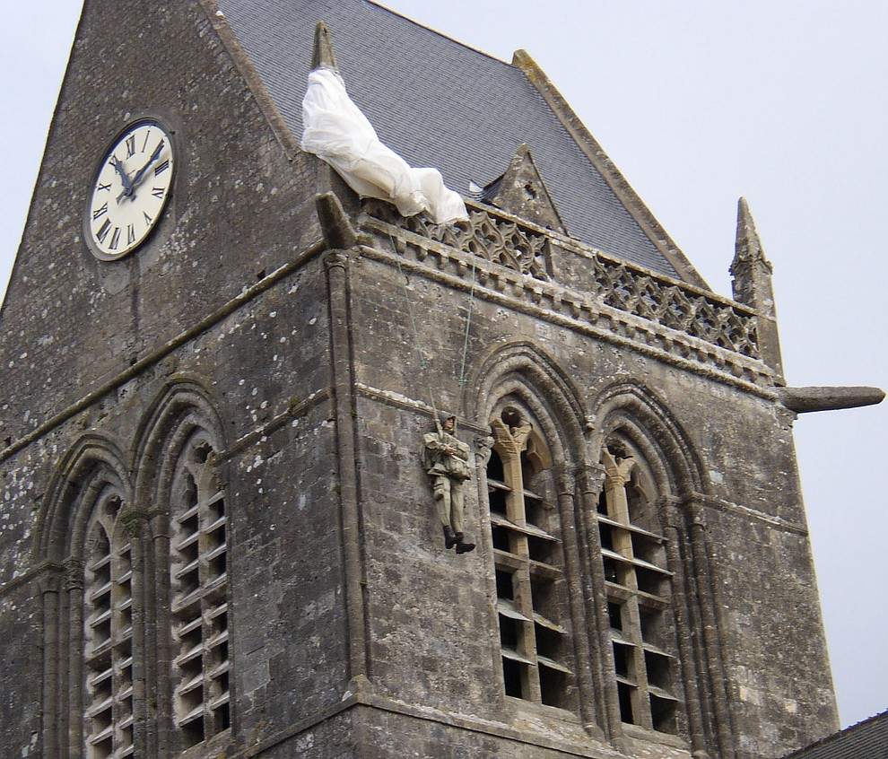 The Cathedral in St. Mere Eglise with a replica of the paratrooper who got hung up on it's steeple photographed during a 2009 tour of the Normandie region of France. (Bill Morrison/Courtesy photo)