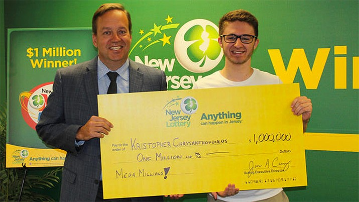 New Jersey college student Kristopher Chrysanthopoulos collects his $1-million winning lottery check. (New Jersey Lottery)