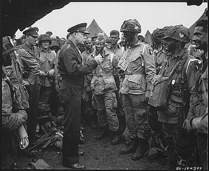 General Dwight D. Eisenhower meets with U.S. paratroopers in England, just before they board their airplanes to participate in the first assault in the invasion of the continent of Europe, the Normandy Invasion. (Photo courtesy of National Archives Catalog)