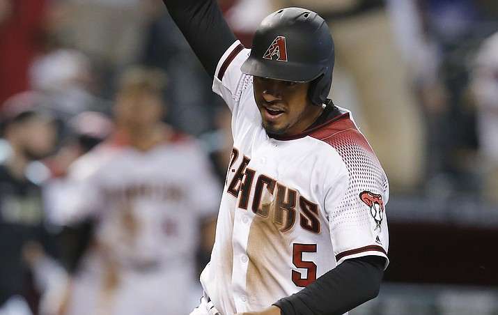 Arizona Diamondbacks' Eduardo Escobar scores the winning run on a single by David Peralta in the 11th inning against the Los Angeles Dodgers 3-2 in a game Wednesday, June 5, 2019, in Phoenix. (Rick Scuteri/AP)