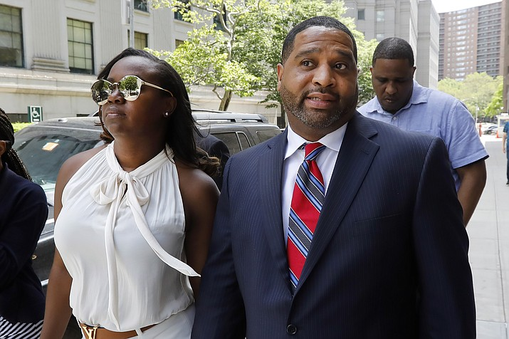 Former University of Arizona assistant men's basketball coach Emanuel Richardson leaves Manhattan federal court in New York, after he was sentenced on a bribery conspiracy charge in the college basketball recruiting scandal that hit major schools, Thursday, June 6, 2019. (Richard Drew/AP)