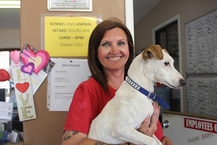 Lead Kennel Tech Janette Silva with one of her favorites. (Photo by Agata Popeda/Daily Miner)