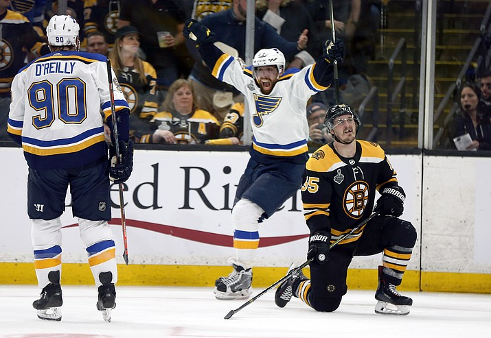 St. Louis Blues' David Perron, center, celebrates his goal behind Boston Bruins' Noel Acciari, right, during the third period in Game 5 of the NHL Stanley Cup Final, Thursday, June 6, 2019, in Boston. (Michael Dwyer/AP)