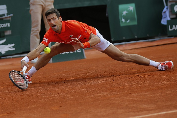 Serbia's Novak Djokovic plays a shot against Germany's Alexander Zverev during their quarterfinal match of the French Open at the Roland Garros stadium in Paris, Thursday, June 6, 2019. (Michel Euler/AP)