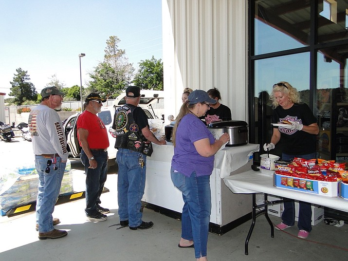"On Saturday, June 1, Grand Canyon Harley Davidson in Mayer sponsored a ""Wheels Helping Wheels"" event featuring classic cars and bikes. Lunch was provided, with the proceeds going to Mayer Meals on Wheels. (Pat Williamson/Courtesy)"