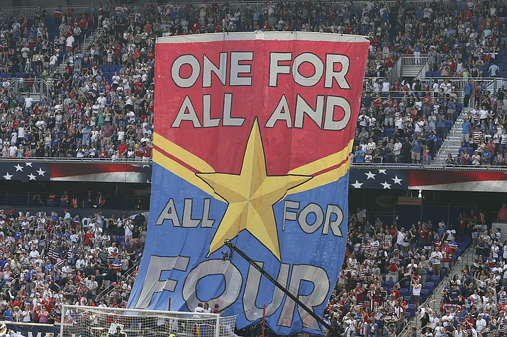 In this Sunday, May 26, 2019, photo, fans hold up a banner in support of the United States women's national team before they compete in the Women's World Cup during an international friendly match between the United States and Mexico in Harrison, N.J. (Steve Luciano/AP, File)
