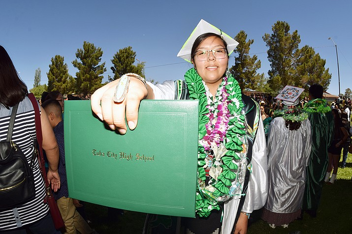 A Tuba City graduate displays her diploma. (Photo courtesy of Krista Allen)