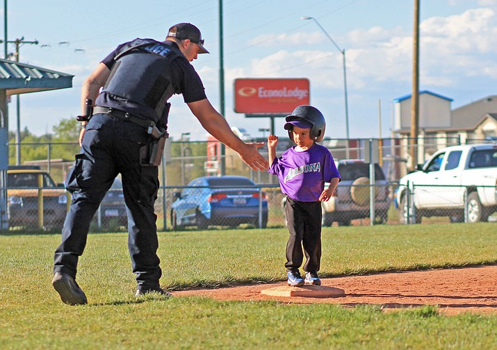 Kohl Nixon coaches a third base runnder during a t-ball game May 31. (Wendy Howell/WGCN)