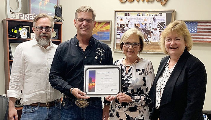 From left, Prescott City Manager Michael Lamar, Mayor Greg Mengarelli, Mayor Pro Tem Billie Orr, and Airport Director Robin Sobotta herald the city's recognition by the FAA for the Prescott Regional Airport being the 2019 Outstanding Airport. (City of Prescott/Courtesy)