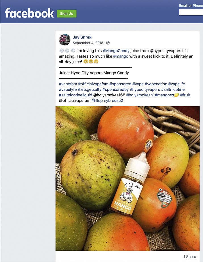 This image captured on Friday, June 7, 2019 shows a Sept. 4, 2018, post on Facebook cited by the U.S. Food and Drug Administration as promoting an e-cigarette formula without including the required nicotine warning statement. On Friday, the FDA sent warning letters to four companies that used paid social media specialists to pitch their fruity and candy nicotine formulas to their online followers. (AP Photo)
