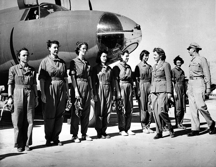 Aviator Nancy Harkness Love, director of the Women's Auxiliary Ferry Squadron (WAFS), and Col. Robert H. Baker, commanding officer, inspect the first contingent of women pilots in the WAFS Sept. 22, 1942, at the New Castle Army Air Base, Del. (AP Photo, File)