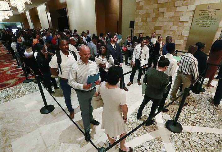 In this Tuesday, June 4, 2019, photo, job applicants line up at the Seminole Hard Rock Hotel & Casino Hollywood during a job fair in Hollywood, Fla. (Wilfredo Lee/AP)