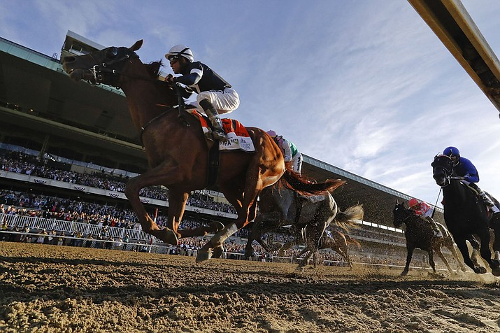 Sir Winston (7), with jockey Joel Rosario up, crosses the finish line to win the 151st running of the Belmont Stakes Saturday in Elmont, N.Y. (AP Photo/Seth Wenig)