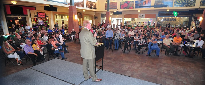 Prescott Chamber Ambassador Leland Moreno-Hilburn addresses a large crowd on Thursday, June 6, as the Prescott Chamber of Commerce and the Gateway Mall welcome more than two dozen new businesses that have opened there in the past year. 