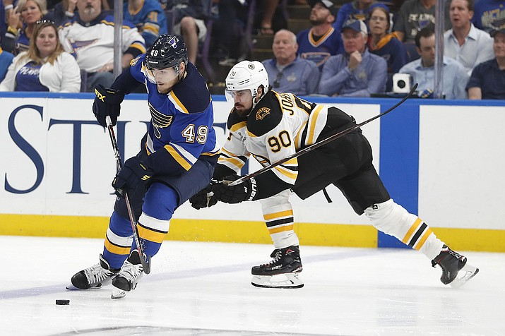 St. Louis Blues center Ivan Barbashev moves the puck ahead of Boston Bruins left wing Marcus Johansson during the third period of Game 3 of the Stanley Cup Final Saturday, June 1, 2019, in St. Louis.  (Jeff Roberson/AP)