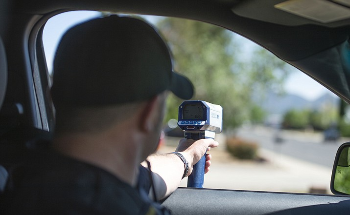 Prescott Valley Police officer Jake Lichlyter checks speeders on Robert Road in Prescott Valley on Friday, June 7, 2019. (Les Stukenberg/ Courier)