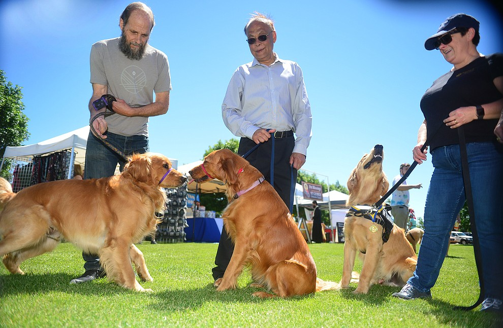 Ron Bistodeau with Frankie, Nitin Oatel with Sora and Debbie Lipely with Teddy Bear at Woofstock at the Civic Center in Prescott Valley Saturday, June 8, 2019. (Les Stukenberg/Courier)