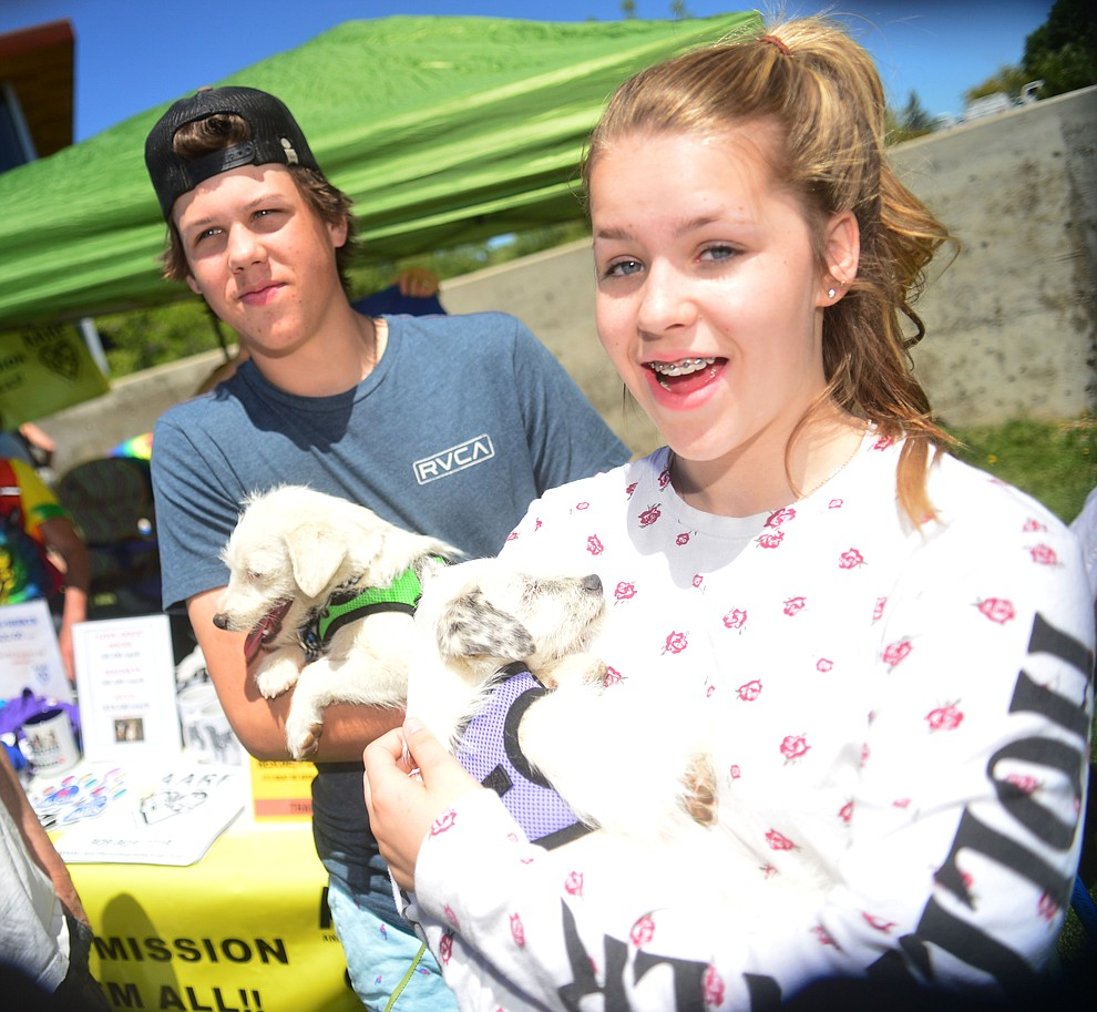 Zane and Eva Torrey adopted a brother and sister puppies at Woofstock at the Civic Center in Prescott Valley Saturday, June 8, 2019. (Les Stukenberg/Courier)