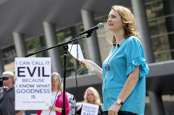 rape survivor and abuse victim advocate Mary DeMuth speaks during a rally Tuesday, June 12, 2018, protesting the Southern Baptist Convention's treatment of women outside the convention's annual meeting at the Kay Bailey Hutchison Convention Center in Dallas. On Tuesday, June 11, 2019, the Southern Baptist Convention gathers for its annual national meeting with one sobering topic _ sex abuse by clergy and staff _ overshadowing all others. (Jeffrey McWhorter/AP, file)