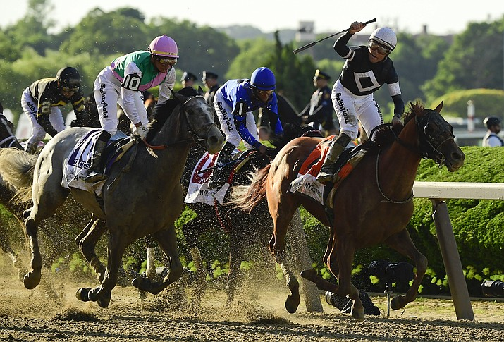 Jockey Joel Rosario, atop Sir Winston (7), right, reacts as after crossing the finish line ahead of Tacitus (10), with jockey Jose Ortiz up, to win the 151st running of the Belmont Stakes horse race, Saturday, June 8, 2019, in Elmont, N.Y. (Steven Ryan/AP)