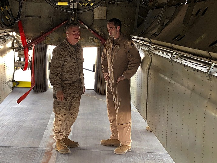 Marine Gen. Frank McKenzie, head of U.S. Central Command, confers with an Air Force officer below the bomb bay of a B-52 bomber on Friday, June 7, 2019 at al-Udeid air base in Qatar. McKenzie said on Friday that he thinks Iran had been planning some sort of attack on shipping or U.S. forces in Iraq. (Robert Burns/AP)