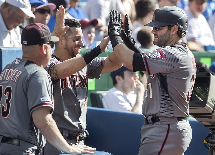 Arizona's Alex Avila, right, is greeted at the dugout after hitting a solo home run against the Blue Jays in the sixth inning in Toronto, Saturday, June 8, 2019. (Fred Thornhill/The Canadian Press via AP)