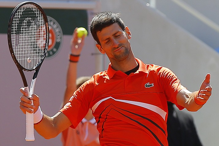 Serbia's Novak Djokovic reacts after missing a shot against Austria's Dominic Thiem in their semifinal match of the French Open at the Roland Garros stadium in Paris, Saturday, June 8, 2019. (Michel Euler/AP)