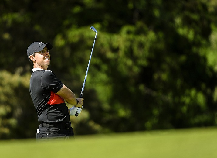 Rory McIlroy, of Northern Ireland, watches his approach shot on the 17th hole during the third round of the Canadian Open in Ancaster, Ontario, Saturday, June 8, 2019. (Nathan Denette/The Canadian Press via AP)