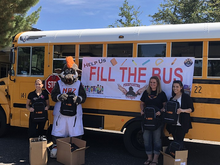 "Members of the Northern Arizona Suns pose for a photo during a ""Fill the Bus"" back-to-school supplies drive with the Humboldt Unified School District. (HUSD/Courtesy)"