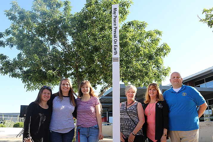 Lee Williams High School Interact Club and Kingman Route 66 Rotary Club at the Peace Pole dedication June 7, 2019. (Photo by Travis Rains/Daily Miner)