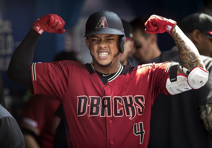 Arizona Diamondbacks' Ketel Marte reacts in the dugout after hitting a solo home run against the Toronto Blue Jays in the third inning of their baseball game in Toronto on Sunday, June 9, 2019. (Fred Thornhill/The Canadian Press via AP)