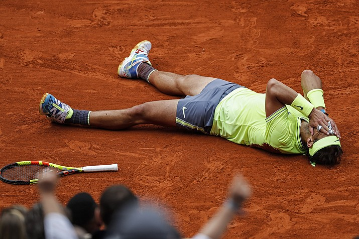 Spain's Rafael Nadal celebrates his record 12th French Open tennis tournament title after winning his men's final match against Austria's Dominic Thiem in four sets, 6-3, 5-7, 6-1, 6-1, at the Roland Garros stadium in Paris, Sunday, June 9, 2019. (Jean-Francois Badias/AP)