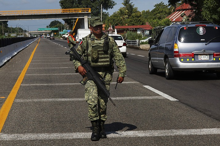 A Mexican Army soldier walks on the highway, near an immigration checkpoint in Tapachula, Chiapas state, Mexico, Saturday June 8, 2019. (Marco Ugarte/AP)