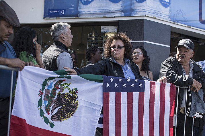 "Lilia Lara, a Tijuana resident, displays the U.S. and Mexican flags at the plaza where Mexican President Andres Lopez Obrador is to hold a rally in Tijuana, Mexico, Saturday, June 8, 2019. President Trump has put on hold his plan to begin imposing tariffs on Mexico on Monday, saying the U.S. ally will take ""strong measures"" to reduce the flow of Central American migrants into the United States. Lara said she arrived early to get a good spot for the rally. (Hans-Maximo Musielik/AP)"
